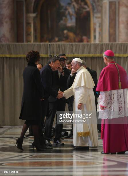 Pope Francis greeting the Prime Minister of Italy Matteo Renzi accompanied by his wife Agnese Landini during the celebration for the closing of the...