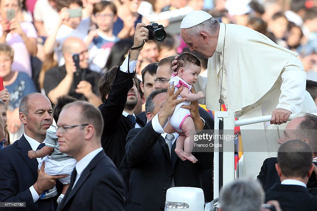 Pope Francis greets a baby as he arrives in St. Peter's Square for a meeting with the Roman Diocesans on June 14, 2015 in Vatican City, Vatican. The Pontiff invited everyone to pay attention to environmental issues during his Sunday Angelus blessing. His upcoming encyclical 'Laudato Sii' on the environment will be launched at a Vatican on Thursday.