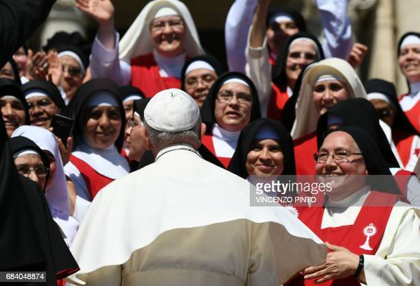 Pope Francis greets a group of nuns at the end of a weekly general audience at St Peter's square on May 17 2017 in Vatican / AFP PHOTO / Vincenzo...