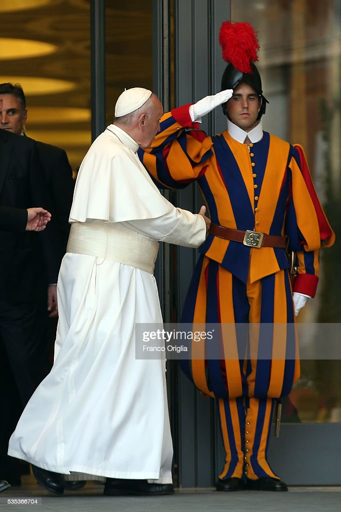 <a gi-track='captionPersonalityLinkClicked' href=/galleries/search?phrase=Pope+Francis&family=editorial&specificpeople=2499404 ng-click='$event.stopPropagation()'>Pope Francis</a> greets a Swiss Guard as he leaves at the end of 'Un Muro o Un Ponte' Seminary held by <a gi-track='captionPersonalityLinkClicked' href=/galleries/search?phrase=Pope+Francis&family=editorial&specificpeople=2499404 ng-click='$event.stopPropagation()'>Pope Francis</a> at the Paul VI Hall on May 29, 2016 in Vatican City, Vatican.