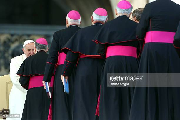 Pope Francis greets bishops during his weekly General Audience in St Peter's Square on January 15 2014 in Vatican City Vatican During the weekly...