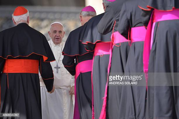 Pope Francis greets cardinals and bishops at the end of a weekly general audience at St Peter's square on October 8 2014 at the Vatican AFP PHOTO /...