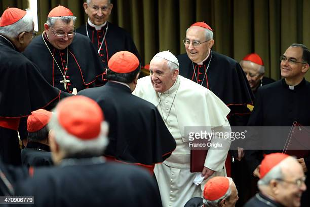 Pope Francis greets cardinals as he arrives at the Synod Hall for the morning session of Extraordinary Consistory on the themes of Family on February...