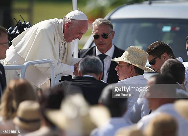 Pope Francis greets Cuban President Raul Castro as he arrives in the Plaza de la Revolution to hold a mass in the square on September 21 2015 in...