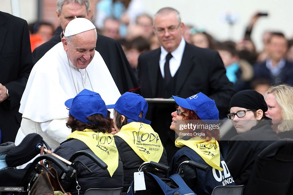 Pope Francis greets faithful and pilgrims as he arrives in St. Peter's Square for his weekly audience on March 4, 2015 in Vatican City, Vatican. Speaking to the crowds gathered in St Peter's Square for the weekly General Audience the Pope continued in his series of teachings on the family, focusing this time on the role of grandparents.