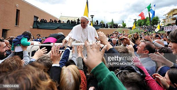 Pope Francis greets faithfuls at the end of an openair mass outside the church of Saints Elizabeth and Zachary in the northern Rome suburb of Prime...