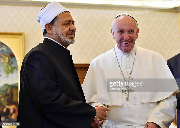 Pope Francis greets Grand Imam of AlAzhar Sheik Ahmed Muhammad AlTayyib during an audience at his private library in the Apostolic Palace on May 23...