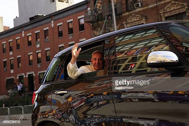 Pope Francis greets guests upon his arrival at Our Lady Queen of Angels School on September 25 2015 in the East Harlem neighborhood of New York City...