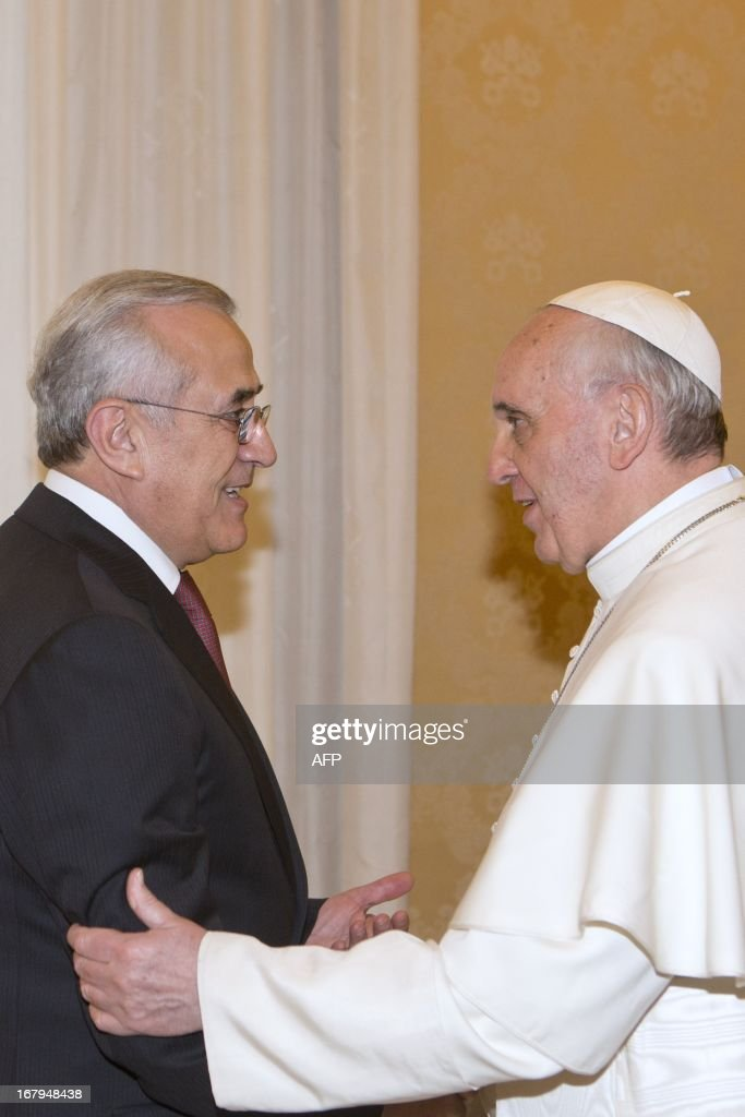Pope Francis (R) greets Lebanese President Michel Suleiman during a private audience in the pontiff's library at the Vatican on May 3, 2013.