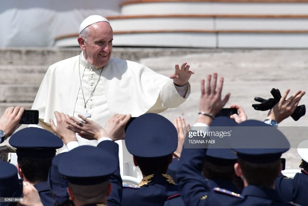 Pope Francis greets members of the Italian Air Force at the end of an audience as part of the Jubilee Year of Mercy on April 30, 2016 at St Peter's square in Vatican.