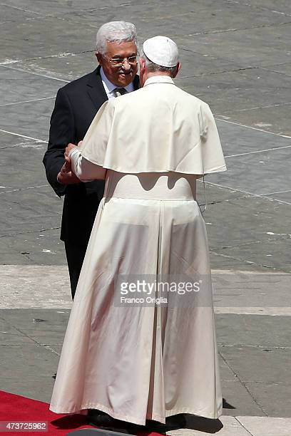 Pope Francis greets Palestinian President Mahmoud Abbas as he leaves St Peter's Square at the end of a canonisation ceremony on May 17 2015 in...