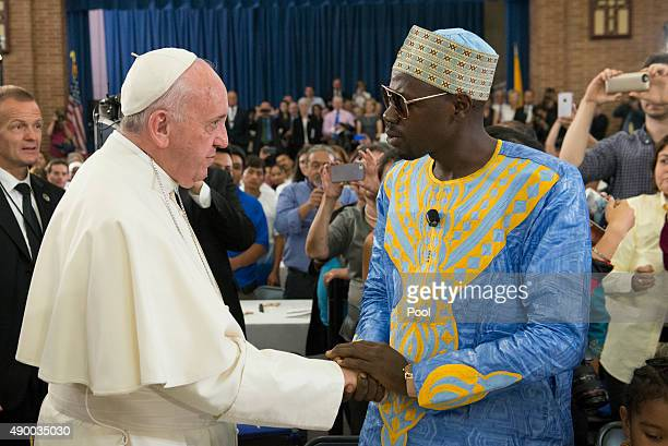 Pope Francis greets people inside Our Lady Queen of Angels School September 25 2015 in the East Harlem neighborhood of New York City Pope Francis is...