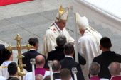 Pope Francis greets Pope Emeritus Benedict XVI at the end of the Canonization Mass in which John Paul II and John XXIII have been declared Saints on...