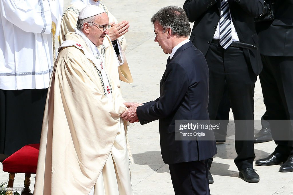 Pope Francis greets President of Colombia Juan Manuel Santos Calderon at the end of the Holy Mass and Canonization Ceremony at St. Peter's Square on May 12, 2013 in Vatican City, Vatican. The pontiff today canonized over 800 new saints; Antonio Primaldo and his companions, martyrs of Otranto in Italy; first Colombian Saint in history Laura di Santa Caterina da Siena Montoya y Upegui, virgin and foundress; and the Mexican Maria Guadalupe Garcia Zavala, co-foundress.