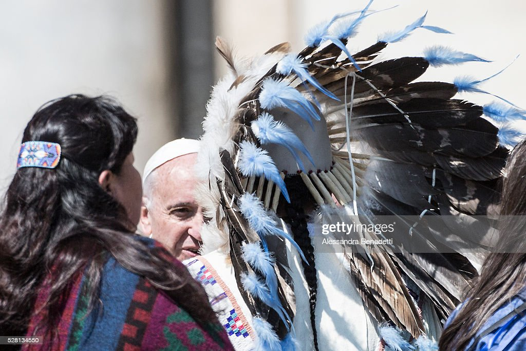 Pope Francis greets some Native Americans during his General Weekly Audience in St. Peter's Square in Vatican City, Vatican.(Photo by Alessandra Benedetti/Corbis via Getty Images).