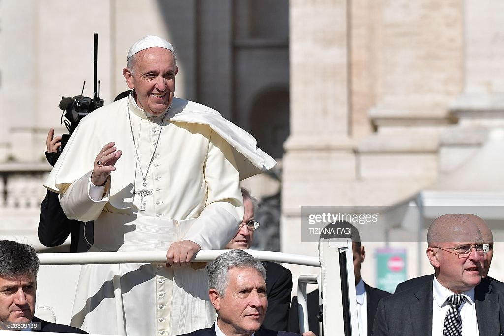 Pope Francis greets the crowd as he arrives for an audience as part of the Jubilee Year of Mercy on April 30, 2016 at St Peter's square in Vatican.