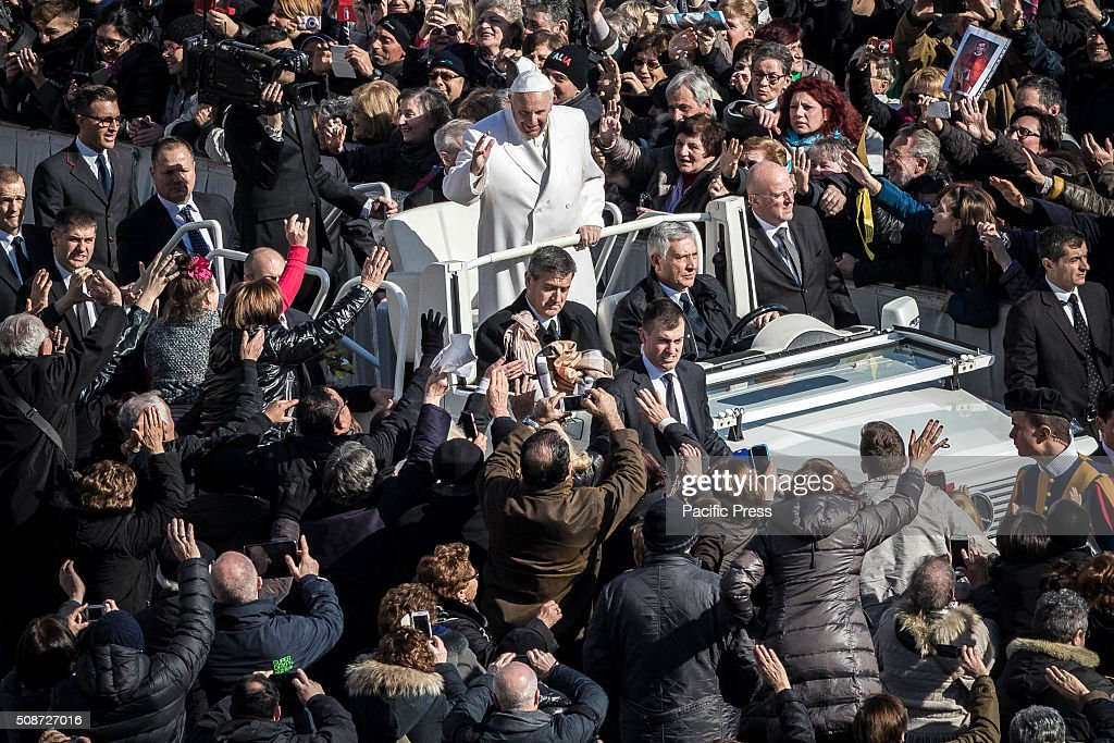 Pope Francis greets the crowd as he arrives for an audience to the Padre Pio Prayer Groups at the Vatican. Padre Pio became famous for bearing the stigmata, which are the marks of Christ, for most of his life, thereby generating much interest and controversy. He was both beatified (1999) and canonized (2002) by Pope John Paul II.