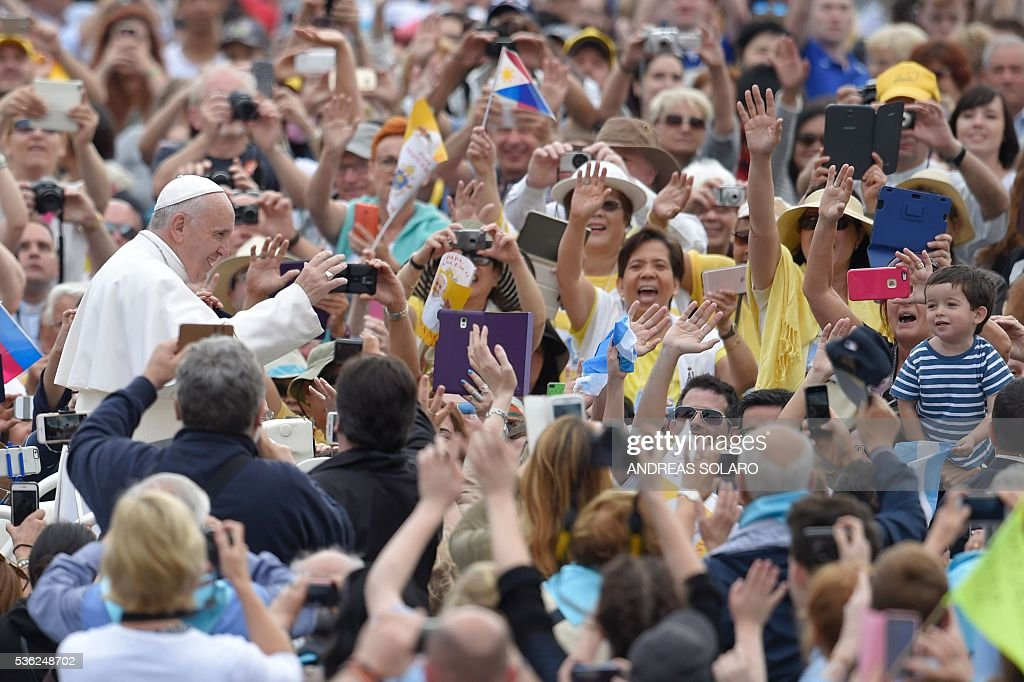 Pope Francis greets the crowd as he arrives for his weekly general audience at St Peter's square on June 1, 2016 at the Vatican.