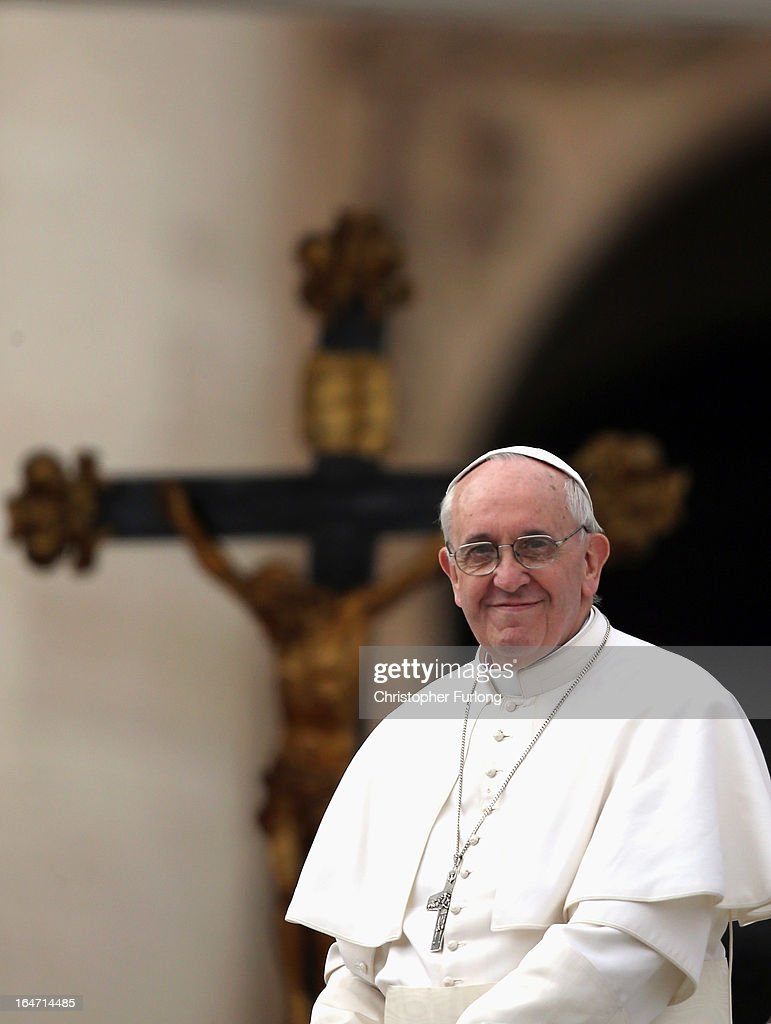 <a gi-track='captionPersonalityLinkClicked' href=/galleries/search?phrase=Pope+Francis&family=editorial&specificpeople=2499404 ng-click='$event.stopPropagation()'>Pope Francis</a> greets the crowd as he drives around St Peter's Square after his first weekly general audience as pope on March 27, 2013 in Vatican City, Vatican. <a gi-track='captionPersonalityLinkClicked' href=/galleries/search?phrase=Pope+Francis&family=editorial&specificpeople=2499404 ng-click='$event.stopPropagation()'>Pope Francis</a> held his weekly general audience in St Peter's Square today