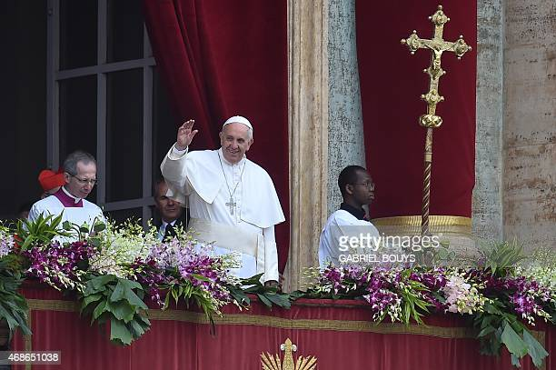Pope Francis greets the crowd from the central loggia of St Peters' basilica before the 'Urbi et Orbi' blessing for Rome and the world after the...