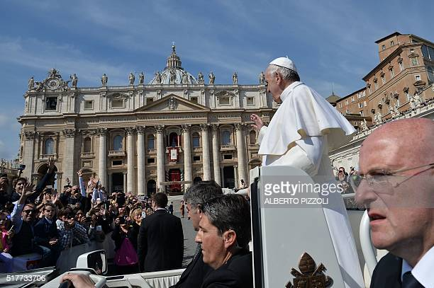 Pope Francis greets the crowd from the popemobile after the Easter Sunday mass on March 27 2016 at St Peter's square in Vatican Christians around the...