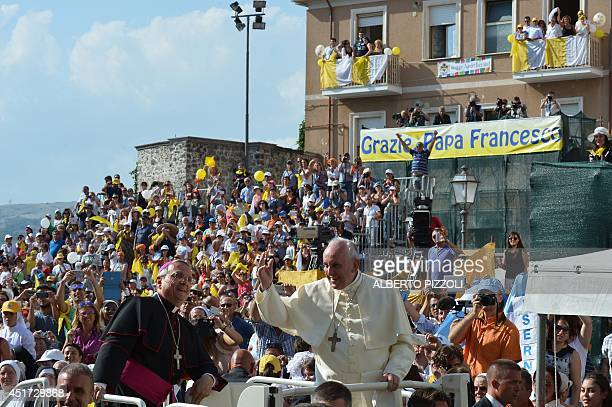 Pope Francis greets the crowd in Isernia southern Italy on July 5 2014 during a one day visit in the Molise region AFP PHOTO / ALBERTO PIZZOLI