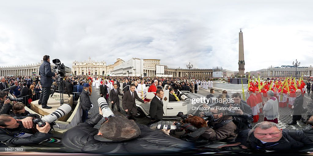 <a gi-track='captionPersonalityLinkClicked' href=/galleries/search?phrase=Pope+Francis&family=editorial&specificpeople=2499404 ng-click='$event.stopPropagation()'>Pope Francis</a> greets the faithful after conducting Palm Sunday Mass on March 24, 2013 in Vatican City, Vatican. <a gi-track='captionPersonalityLinkClicked' href=/galleries/search?phrase=Pope+Francis&family=editorial&specificpeople=2499404 ng-click='$event.stopPropagation()'>Pope Francis</a> lead his first mass of Holy Week as pontiff by celebrating Palm Sunday in front of thousands of faithful and clergy. The pope's first holy week will also incorporate him washing the feet of prisoners in a youth detention centre in Rome next Thursday, 28th March.