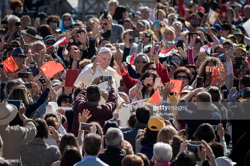 S SQUARE, VATICAN CITY, VATICAN - : Pope Francis greets the faithful as he arrives to celebrate his Weekly General Audience in St. Peter's Square. Pope Francis says God loves each and every one of us, He is totally extraneous to the throwaway culture of today and like the good shepherd he does not want a single person to be lost.