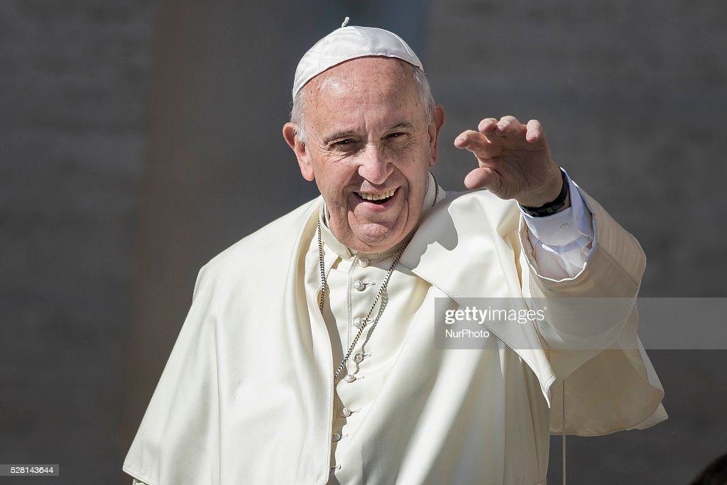 Pope Francis greets the faithful as he arrives to celebrate his Weekly General Audience in St. Peter's Square in Vatican City, Vatican on May 04, 2016. Pope Francis says God loves each and every one of us, He is totally extraneous to the throwaway culture of today and like the good shepherd he does not want a single person to be lost.