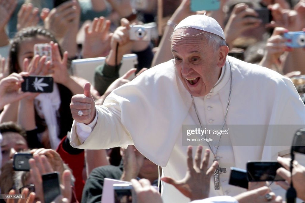 Pope Francis greets the faithful as he holds Easter Mass in St Peter's Square on April 20 2014 in Vatican City Vatican Pope Francis is attending the...
