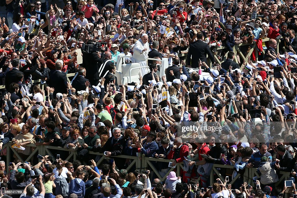 <a gi-track='captionPersonalityLinkClicked' href=/galleries/search?phrase=Pope+Francis&family=editorial&specificpeople=2499404 ng-click='$event.stopPropagation()'>Pope Francis</a> greets the faithful as he holds Easter Mass in St. Peter's Square on April 20, 2014 in Vatican City, Vatican. <a gi-track='captionPersonalityLinkClicked' href=/galleries/search?phrase=Pope+Francis&family=editorial&specificpeople=2499404 ng-click='$event.stopPropagation()'>Pope Francis</a> is attending the Holy Week for his second time as a Pontiff. Using the global twitter network, yesterday he asked people worldwide to join him in prayer for the victims of the tragic ferry disaster in South Korea.