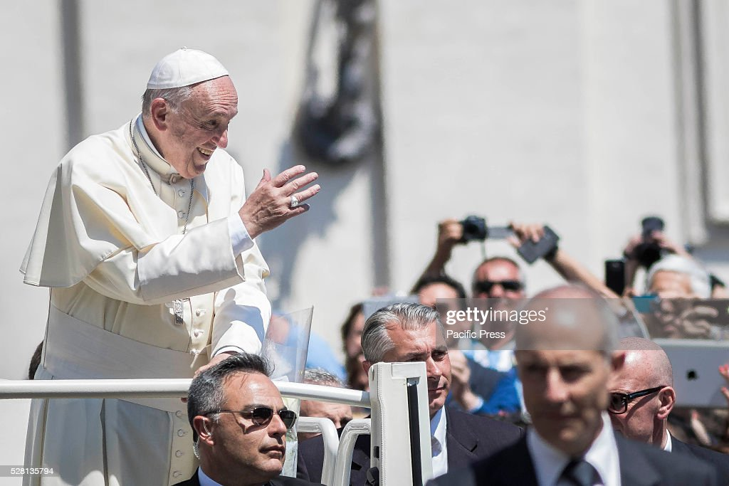 S SQUARE, VATICAN CITY, VATICAN - : Pope Francis greets the faithful as he leaves at the end of his Weekly General Audience in St. Peter's Square. Pope Francis says God loves each and every one of us, He is totally extraneous to the throwaway culture of today and like the good shepherd he does not want a single person to be lost.