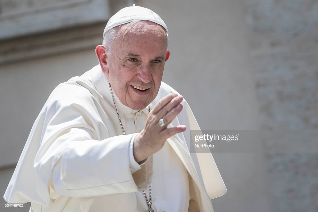 Pope Francis greets the faithful as he leaves at the end of his Weekly General Audience in St. Peter's Square in Vatican City, Vatican on May 25, 2016. At the conclusion of his weekly General Audience, Pope Francis prayed for the victims of terrorist attacks that took place in Syria on Monday.