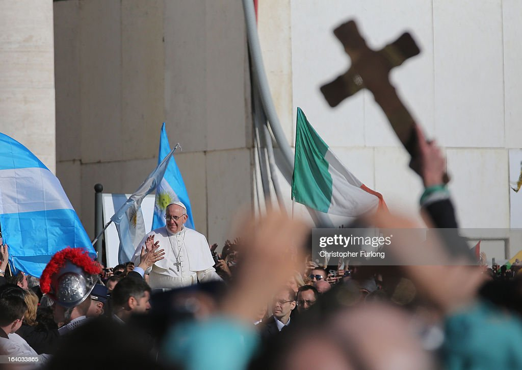 Pope Francis greets the faithful during the Inauguration Mass for Pope Francis in St Peter's Square on March 19, 2013 in Vatican City, Vatican. The mass was held in front of an estimated crowd of up to one million pilgrims and faithful who have filled the square and the surrounding streets to see the former Cardinal of Buenos Aires officially take up his role as pontiff. Pope Francis' inauguration took place in front of Cardinals and spiritual leaders as well as heads of state from around the world.
