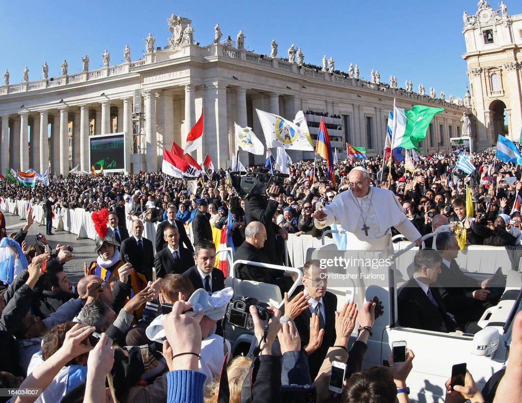 <a gi-track='captionPersonalityLinkClicked' href=/galleries/search?phrase=Pope+Francis&family=editorial&specificpeople=2499404 ng-click='$event.stopPropagation()'>Pope Francis</a> greets the faithful during the Inauguration Mass for <a gi-track='captionPersonalityLinkClicked' href=/galleries/search?phrase=Pope+Francis&family=editorial&specificpeople=2499404 ng-click='$event.stopPropagation()'>Pope Francis</a> in St Peter's Square on March 19, 2013 in Vatican City, Vatican. The mass was held in front of an estimated crowd of up to one million pilgrims and faithful who have filled the square and the surrounding streets to see the former Cardinal of Buenos Aires officially take up his role as pontiff. <a gi-track='captionPersonalityLinkClicked' href=/galleries/search?phrase=Pope+Francis&family=editorial&specificpeople=2499404 ng-click='$event.stopPropagation()'>Pope Francis</a>' inauguration took place in front of Cardinals and spiritual leaders as well as heads of state from around the world.