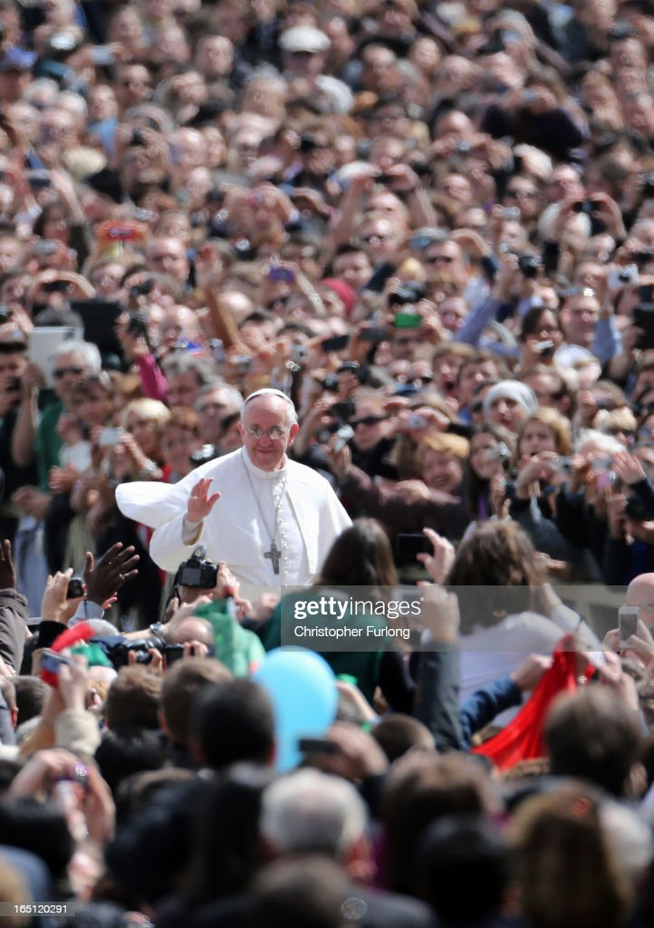 <a gi-track='captionPersonalityLinkClicked' href=/galleries/search?phrase=Pope+Francis&family=editorial&specificpeople=2499404 ng-click='$event.stopPropagation()'>Pope Francis</a> greets the faithful in his pope mobile prior to his first 'Urbi et Orbi' blessing from the balcony of St. Peter's Basilica during Easter Mass on March 31, 2013 in Vatican City, Vatican. <a gi-track='captionPersonalityLinkClicked' href=/galleries/search?phrase=Pope+Francis&family=editorial&specificpeople=2499404 ng-click='$event.stopPropagation()'>Pope Francis</a> delivered his message to the gathered faithful from the central balcony of St. Peter's Basilica in St. Peter's Square after his first Holy week as Pontiff.
