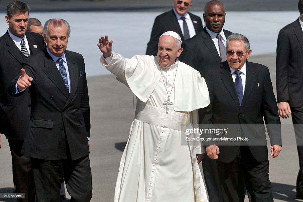 <a gi-track='captionPersonalityLinkClicked' href=/galleries/search?phrase=Pope+Francis&family=editorial&specificpeople=2499404 ng-click='$event.stopPropagation()'>Pope Francis</a> (C) greets the press as he walks on the tarmac next to Cuba's president <a gi-track='captionPersonalityLinkClicked' href=/galleries/search?phrase=Raul+Castro&family=editorial&specificpeople=239452 ng-click='$event.stopPropagation()'>Raul Castro</a> (R) upon his arrival in Cuba, on February 12, 2016, in Havana, Cuba. <a gi-track='captionPersonalityLinkClicked' href=/galleries/search?phrase=Pope+Francis&family=editorial&specificpeople=2499404 ng-click='$event.stopPropagation()'>Pope Francis</a> met with Russian Orthodox Patriarch Kirill at Havana's Jose Marti airport, marking the first meeting between the heads of the two churches some 1,000 years since the breakup of the two Christian churches.