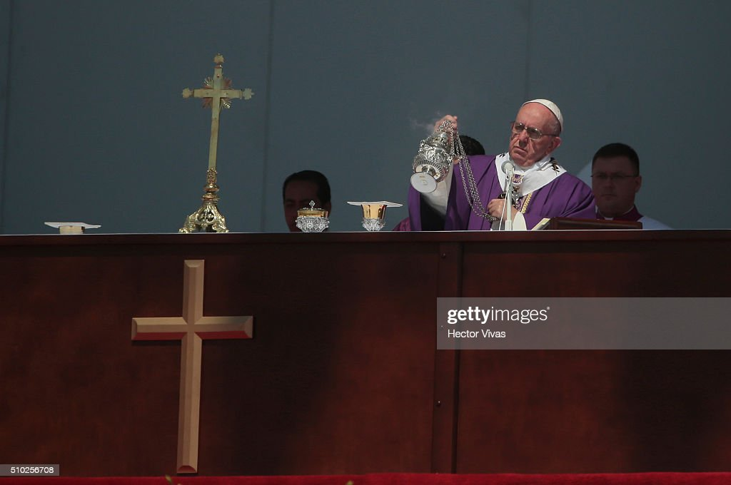 Pope Francis hands a censer during a mass for the people at El Caracol on February 14, 2016 in Ecatepec, Mexico. Pope Francis is on a five-day visit in Mexico from February 12 to 17 where he is expected to visit five states.