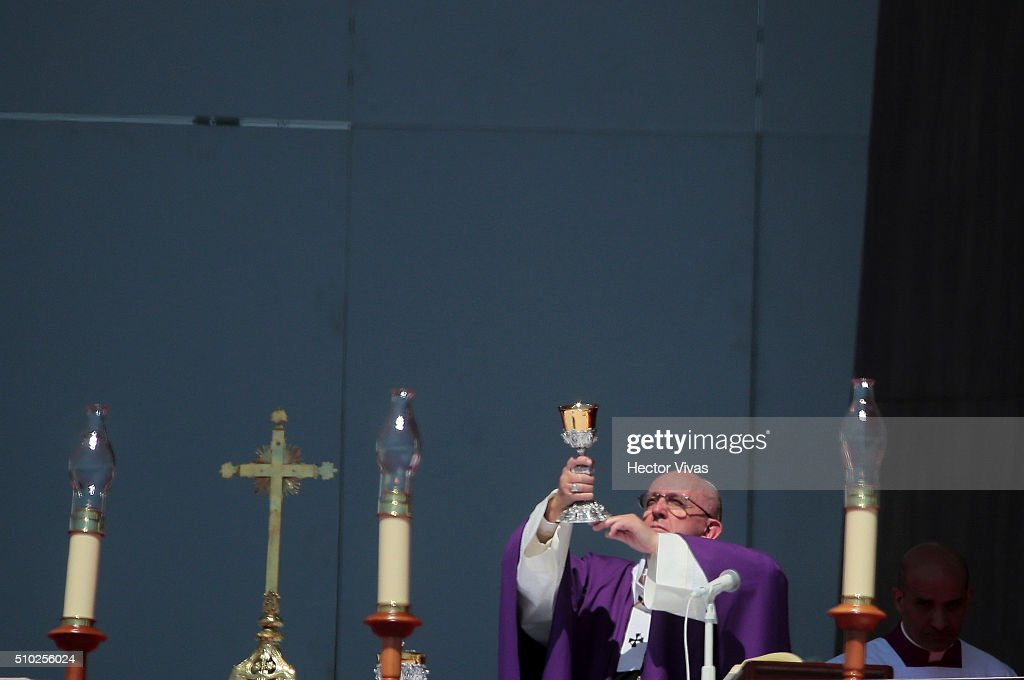 Pope Francis hands the chalice during a mass for the people at Ecatepec on February 14, 2016 in Ecatepec, Mexico. Pope Francis is on a five days visit in Mexico from February 12 to 17 where he is expected to visit five states.