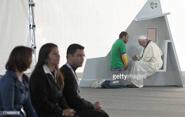 Pope Francis hears confessions of young people in the park of the Quinta Da Boa Vista in Rio de Janeiro Brazil on July 26 2013 Pope Francis returned...