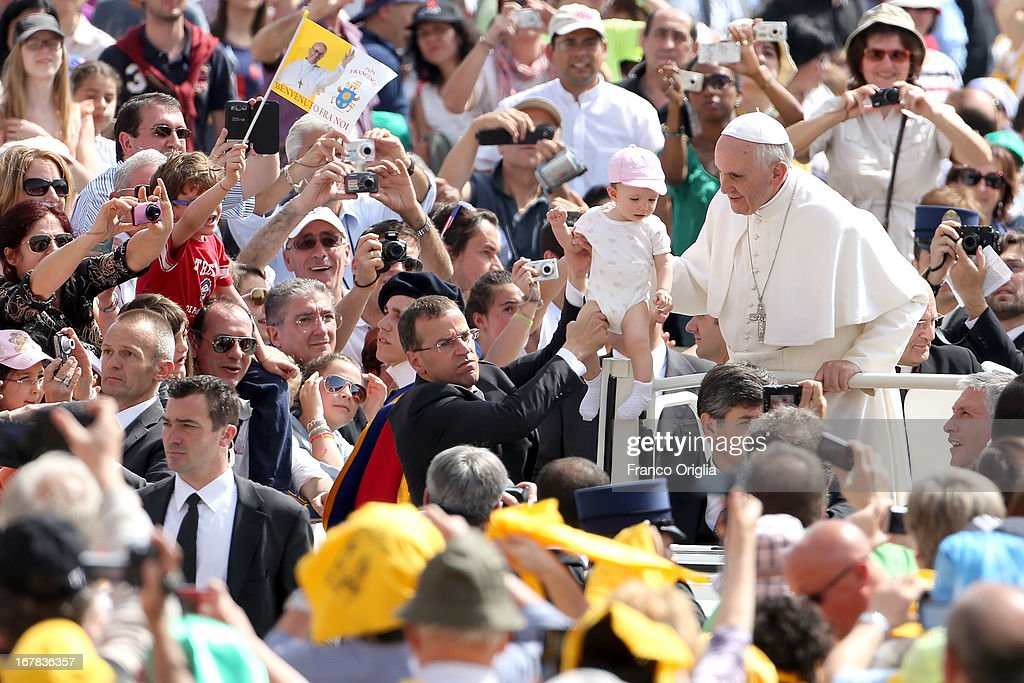 <a gi-track='captionPersonalityLinkClicked' href=/galleries/search?phrase=Pope+Francis&family=editorial&specificpeople=2499404 ng-click='$event.stopPropagation()'>Pope Francis</a> holds a child as he arrives in St. Peter's Square for his Weekly Audience on May 1, 2013 in Vatican City, Vatican. Marking the feast of St Joseph the Worker and World Labor Day today, the Pontiff launched an urgent appeal to Christians and men and women of goodwill worldwide to take decisive steps to end slave labor.