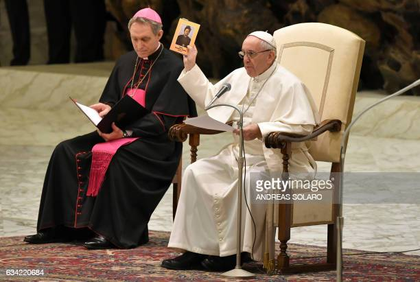 Pope Francis holds up an icon of Sudanese saint Josephine Bakhita during a general audience at the Paul VI Audience Hall at the Vatican on February 8...