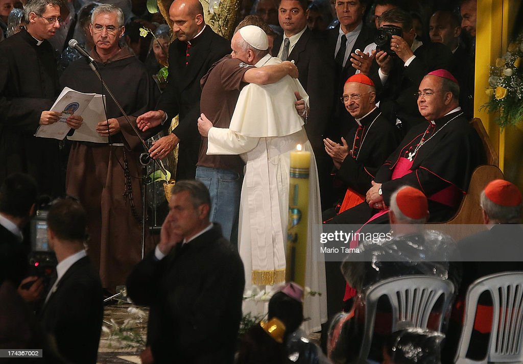 <a gi-track='captionPersonalityLinkClicked' href=/galleries/search?phrase=Pope+Francis&family=editorial&specificpeople=2499404 ng-click='$event.stopPropagation()'>Pope Francis</a> hugs a man at the Hospital de Sao Francisco de Assis (Hospital of Saint Francis of Assisi) on July 24, 2013 in Rio de Janeiro, Brazil. More than 1.5 million pilgrims are expected to join <a gi-track='captionPersonalityLinkClicked' href=/galleries/search?phrase=Pope+Francis&family=editorial&specificpeople=2499404 ng-click='$event.stopPropagation()'>Pope Francis</a> for his visit to the Catholic Church's World Youth Day celebrations. <a gi-track='captionPersonalityLinkClicked' href=/galleries/search?phrase=Pope+Francis&family=editorial&specificpeople=2499404 ng-click='$event.stopPropagation()'>Pope Francis</a> will deliver his welcome address to the celebrations on Copacabana Beach on July 25 as World Youth Day runs July 23-28.
