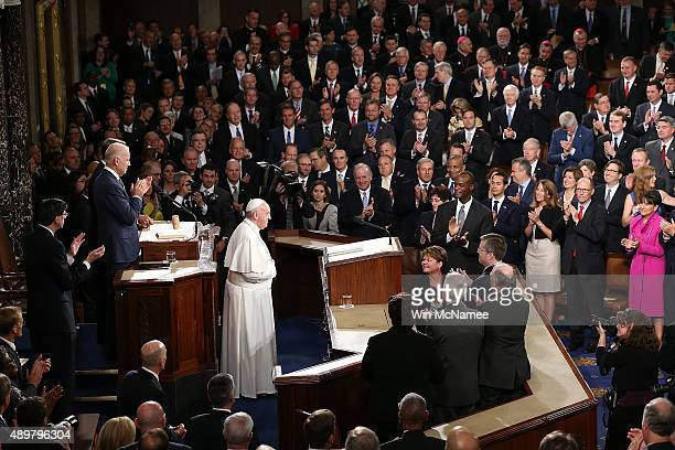 Pope Francis is applauded by members of Congress as he arrives to speak during a joint meeting of the US Congress in the House Chamber of the US...