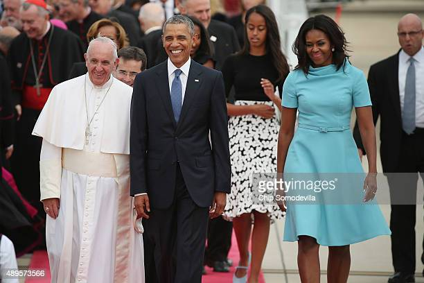 Pope Francis is escorted by US President Barack Obama first Lady Michelle Obama and their daughters after arriving from Cuba September 22 2015 at...