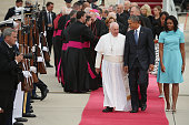 Pope Francis is escorted by US President Barack Obama first lady Michelle Obama and other political and Catholic church leaders after arriving from...