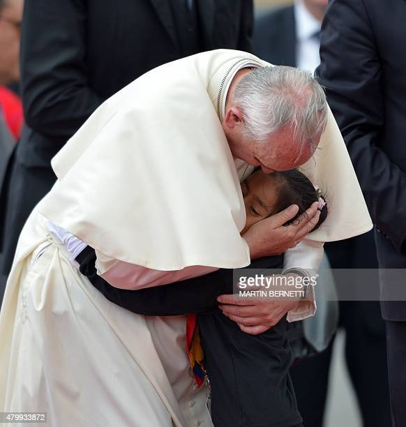 Pope Francis is greeted by a girl at the airport in Quito before his departure for Bolivia on July 8 2015 Pope Francis the first Latin American...