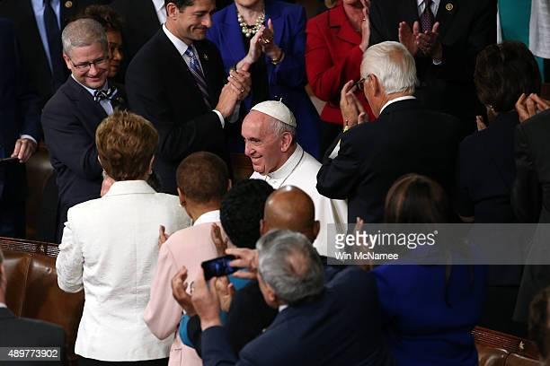 Pope Francis is greeted by members of Congress as he arrives to speak during a joint meeting of the US Congress in the House Chamber of the US...
