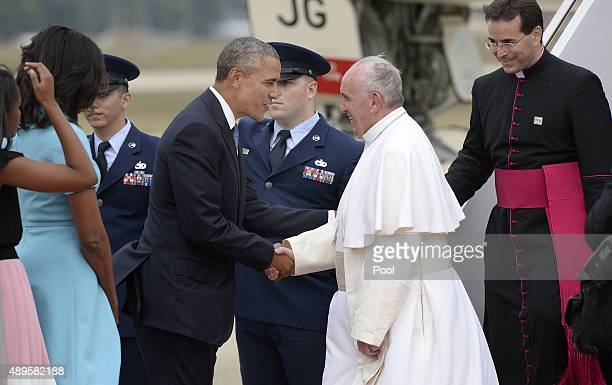 Pope Francis is greeted by US President Barack Obama after the pontiff's arrival from Cuba September 22 2015 at Joint Base Andrews Maryland Francis...