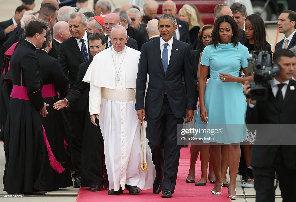 Pope Francis is greeted by US President Barack Obama first lady Michelle Obama and other political and Catholic church leaders after arriving from...